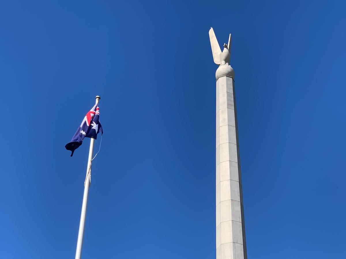 australia-australian-canberra-department-of-defence-russell-office-bird-statue-with-flag-again.jpg