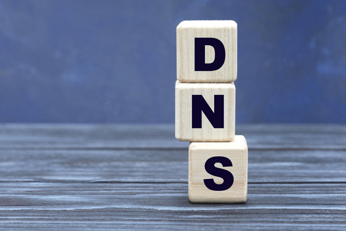 concept word DNS on cubes on a beautiful gray blue background